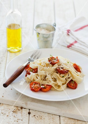 Homemade tagliatelle with roasted cherry tomatoes and thyme