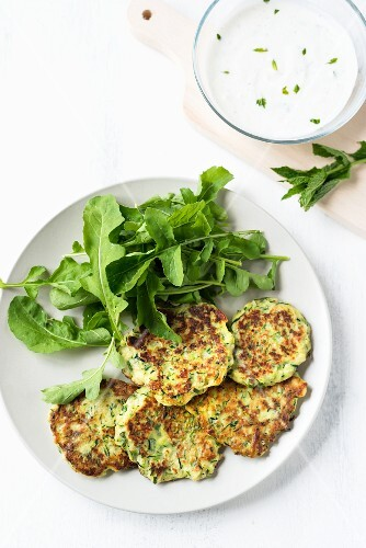 Courgette cakes with a rocket salad