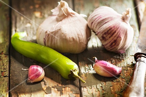 Pink garlic and a green chilli pepper