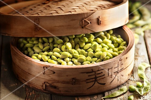 Edamame beans in a steamer basket