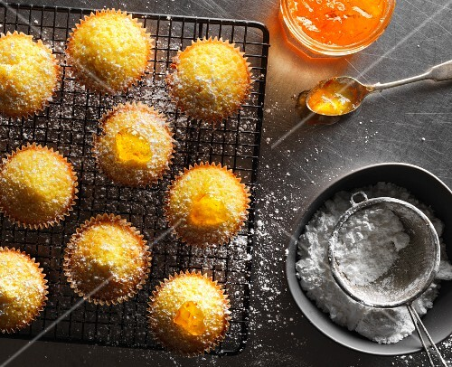 Cupcakes with marmalade and icing sugar