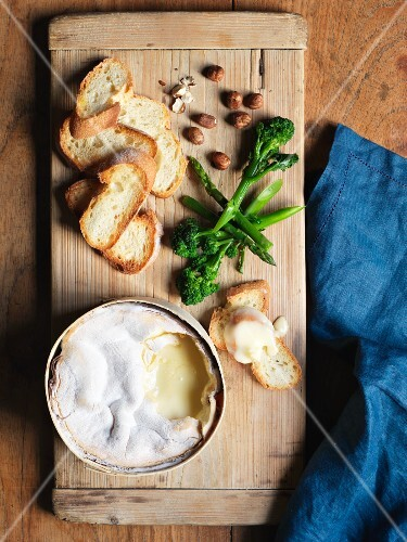 Baked Vacherin with truffle honey, hazelnuts and baguette