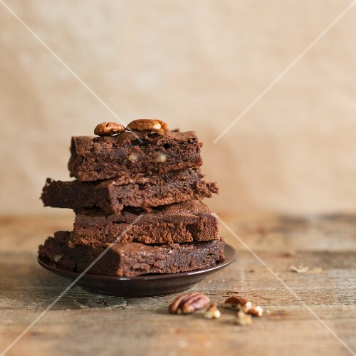 A stack of pecan nut chocolate brownies