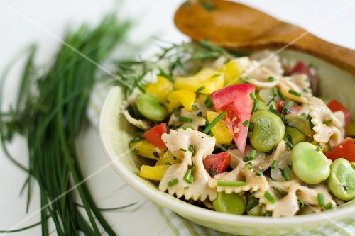 Pasta salad with broad beans, tomatoes, peppers and fresh garden herbs