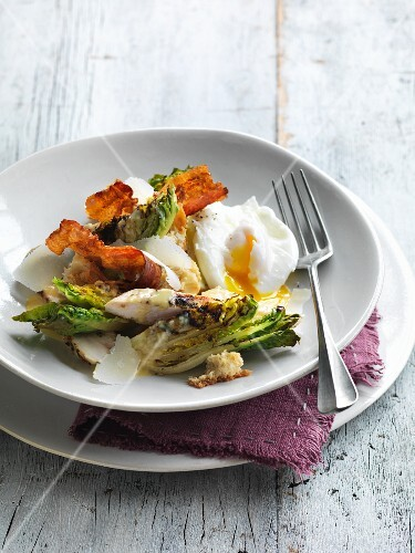 Caesar salad with chicken, bacon and poached egg