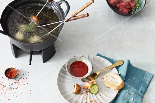 Fondue with vegetables and meat