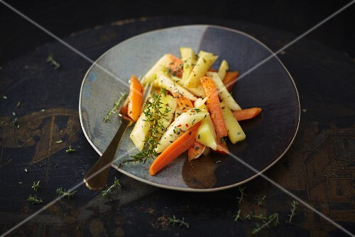 A side of vegetables with carrots and parsnips