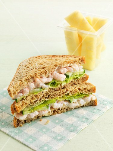 A shrimp sandwich with pineapple
