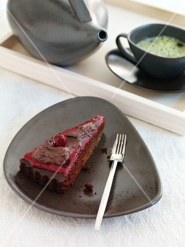 A slice of cherry and chocolate cake