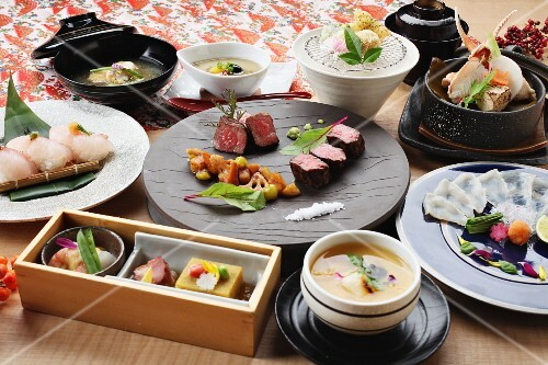 Traditional Japanese dishes: sushi, beef, Tempura and mussels