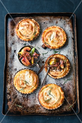 Goat's cheese tartlets on a baking tray