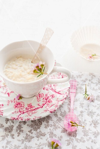 Rice pudding in a cup on a vintage plate