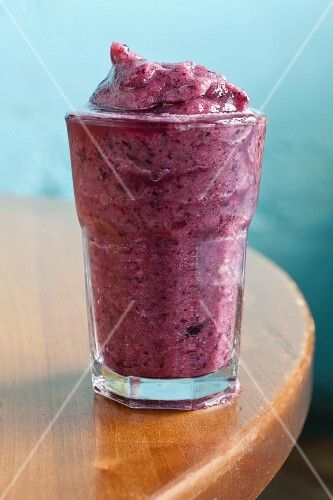 A blueberry and banana smoothie with apple juice