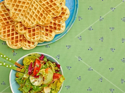 Herb and sour cream waffles served with salad