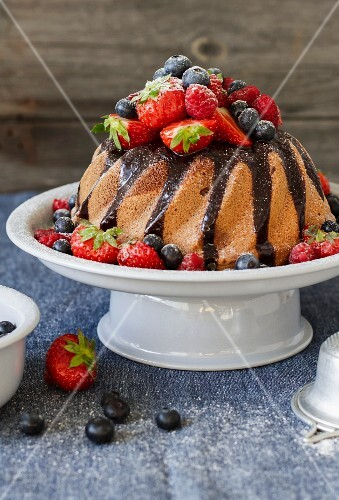 Bundt cake with chocolate glaze and fresh berries