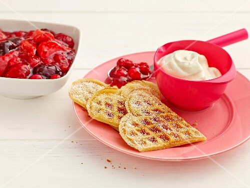 Waffles with red berry jelly and whipped cream