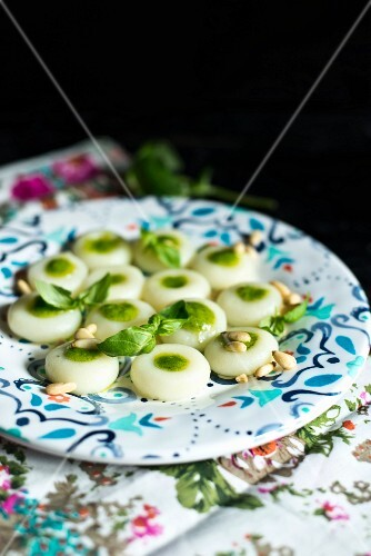 Polish dumplings with pesto and pine nuts