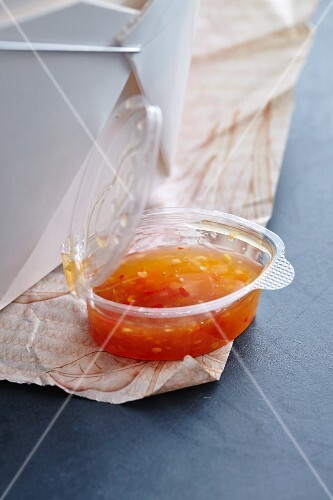 Sweet chilli sauce in a plastic bowl