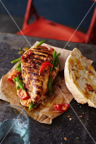 An escalope roll with grilled turkey, tomatoes and beans