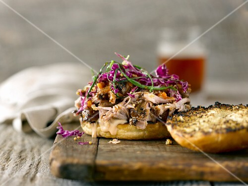 Pulled pork on grilled bread with red cabbage, fried spring onions and Thousand Island dressing