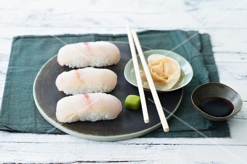 Hamachi nigiri with pickled ginger, wasabi paste and soy sauce