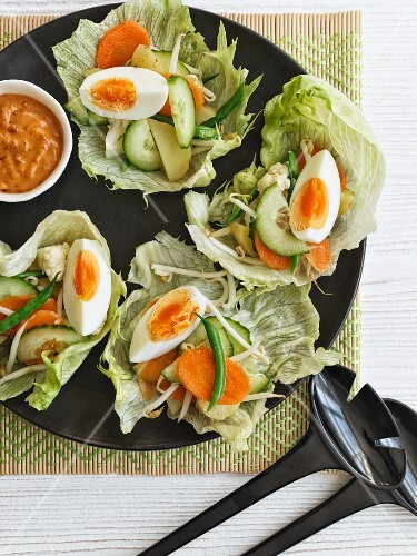 Lettuce leaves filled with vegetables and hard-boiled eggs (Indonesia)