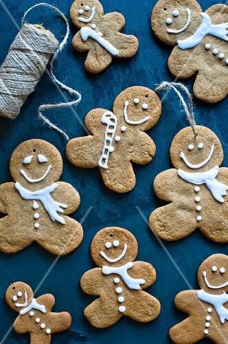 Gingerbread men with icing sugar as Christmas tree decorations