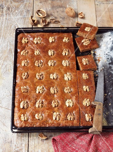 Gingerbread cake with walnuts on a baking tray