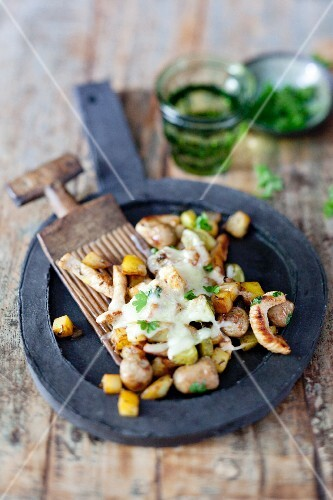 Raclette potato hash with pork and caraway