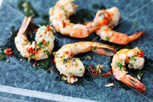 Garlic prawns in a chilli marinade cooked on a hot stone