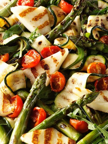 Courgette and asparagus salad with tomatoes and grilled cheese