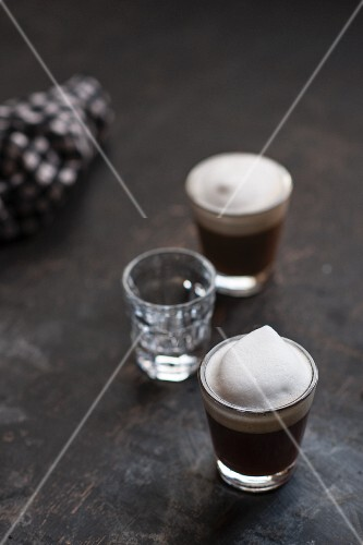 Glasses of espresso topped with milk foam