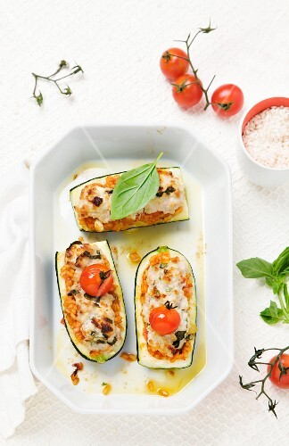 Courgette stuffed with rice, feta cheese and pork