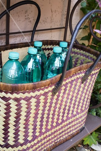 Plastic bottles in a woven bag