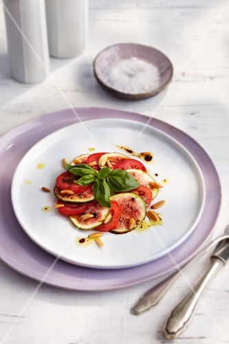 Fig and tomato carpaccio with pine nuts