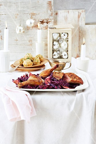 Duck on fig-red cabbage served with bread dumplings for Christmas dinner