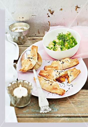 Stuffed puff pastry parcels filled with avocado salad for Christmas