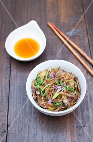 Japchae (glass noodle dish from Korea) with shiitake mushrooms and spinach
