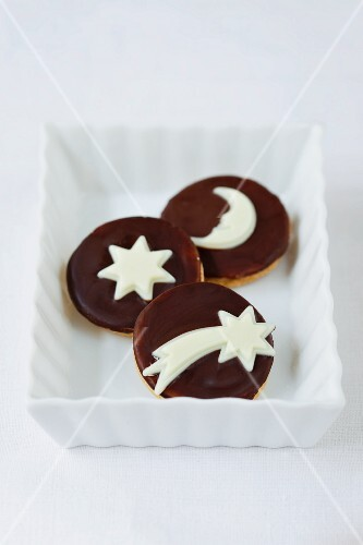 Chocolate biscuits decorated with stars and moons