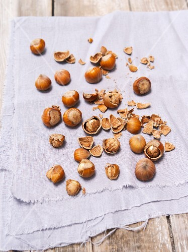 Hazelnuts, partly shelled and unshelled