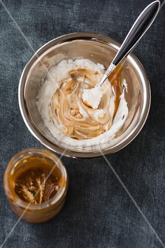 Caramel sauce and cream being mixed to make caramel cream and cinnamon ice cream