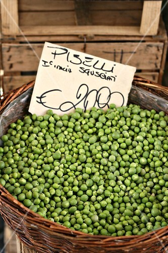 A basket of shelled peas with a price label
