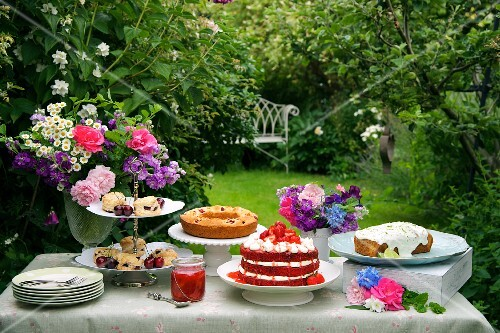 A cake buffet in a summer garden