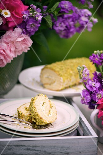Swiss roll with pistachios and rose water on a cake buffet