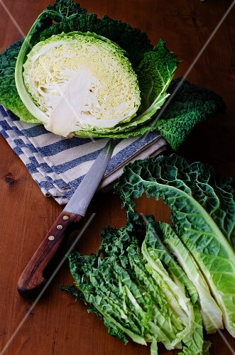 A savoy cabbage halved and cut into strips