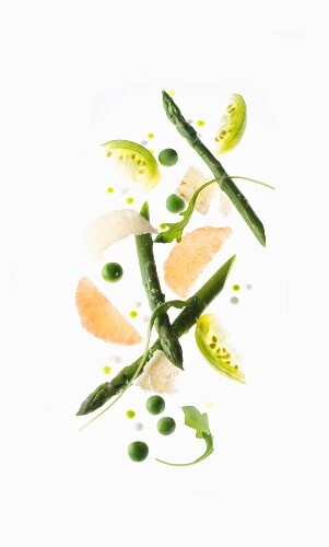 A spring salad with asparagus, parmesan, peas, grapefruit and green tomatoes