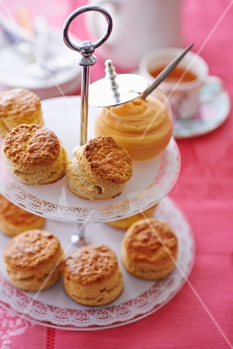 Scones with lemon curd on a cake stand