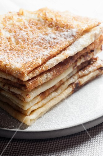 A stack of sugared pancakes