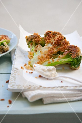 Fried broccoli florets with a Panko coating and a mustard dip