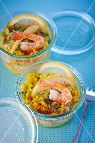 Risotto with prawns and lemons in glasses